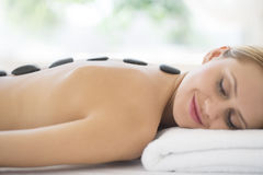 Woman Getting Hot Stone Therapy At Spa Royalty Free Stock Image
