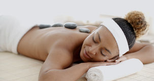 Woman Getting Hot Stones Massage At Spa Royalty Free Stock Photos