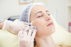 Woman getting an injection in her face Royalty Free Stock Image
