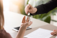 Woman getting keys to new rented own apartment, close up Stock Photo