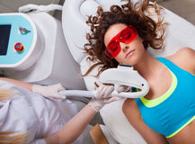 Woman getting laser face treatment. In medical spa center Royalty Free Stock Images