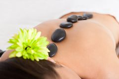 Woman getting lastone massage Royalty Free Stock Images