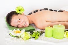 Woman getting lastone massage Stock Photos