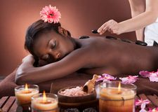 Woman getting lastone therapy at spa Royalty Free Stock Photos