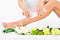 Woman getting legs waxed stock image