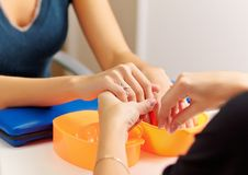 Woman getting a manicure Royalty Free Stock Image