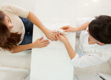 Woman getting a manicure Stock Photography