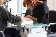 Woman getting manicure at beauty salon Royalty Free Stock Images