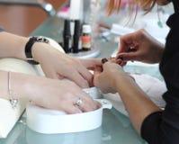 Woman getting manicure at beauty salon Stock Photo