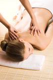 Woman getting a massage stock images