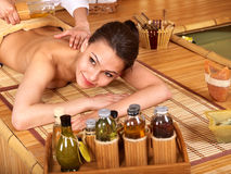 Woman getting massage in bamboo spa. Stock Photos