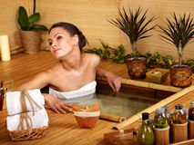 Woman getting massage in bamboo spa. Royalty Free Stock Images