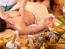Woman getting massage in bamboo spa. Stock Image