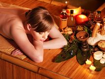 Woman getting massage in bamboo spa. Young woman getting massage in bamboo spa royalty free stock images