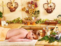 Woman getting massage in bamboo spa. Young woman getting massage in bamboo spa royalty free stock photo