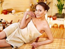 Woman getting massage in bamboo spa. Stock Photo