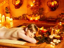 Woman getting massage in bamboo spa. Young woman getting massage in bamboo spa stock photography