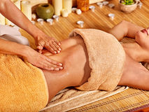 Woman getting massage in bamboo spa Stock Photo