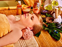Woman getting massage in bamboo spa. Young woman getting massage in bamboo spa royalty free stock photography