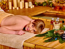 Woman getting massage in bamboo spa. Young woman getting massage in bamboo spa stock photos