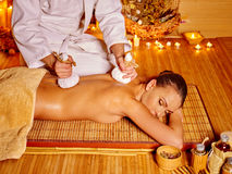 Woman getting massage in bamboo spa Royalty Free Stock Images