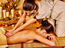 Woman getting massage in bamboo spa Stock Photography