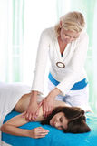 Woman getting massage in day spa Stock Photos