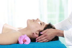 Woman getting massage in day spa. Woman getting relaxing massage in a day spa Stock Photography