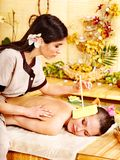 Woman getting massage with ear candle . Royalty Free Stock Photos