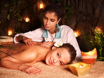 Woman getting massage in luxury spa. Stock Photos