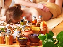 Woman getting massage in luxury spa. Woman getting massage in spa. Still Life in the foreground stock photos