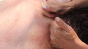 Woman getting massage at the neck stock footage