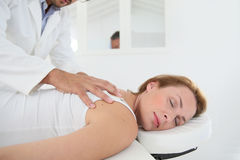 Woman getting a massage by physiotherapist Royalty Free Stock Images