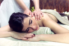 Woman getting massage in relaxing spa dreaming Royalty Free Stock Images