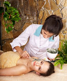 Woman getting massage in spa. Royalty Free Stock Photo