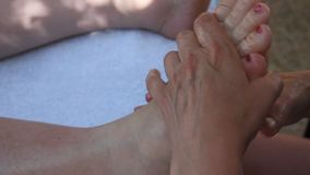 Woman getting massage at toes stock footage