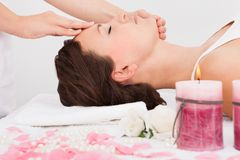 Woman getting massage treatment Stock Images