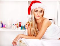 Woman getting massage in Xmas spa. Stock Photos