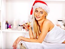 Woman getting massage in Xmas spa. Royalty Free Stock Images