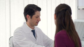Woman getting medical consultation from a doctor in a hospital. stock footage