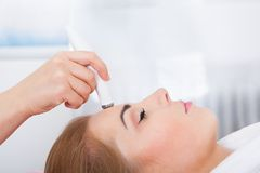 Woman getting microdermabrasion treatment Royalty Free Stock Photo