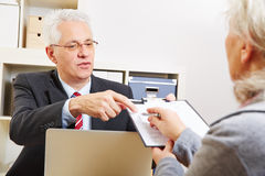 Woman getting minutes. Senior women getting minutes of consultation from her financial consultant Stock Photos