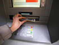 Woman while getting money from atm Stock Photos