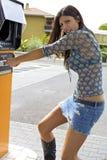 Woman getting money stolen from cash machine Stock Photos