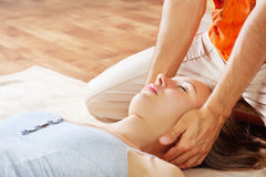 Woman getting neck massage. Relaxed girl massaged his neck Royalty Free Stock Photography