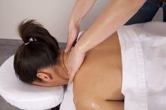 Woman getting neck massaged Stock Photo