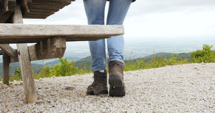 Woman getting out of bench seat stock footage