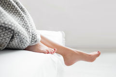 Woman getting out cozy bed, first awake step stock image