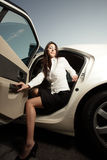 Woman getting out of her car Royalty Free Stock Photography