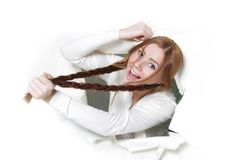 Woman getting out from hole in paper Stock Images